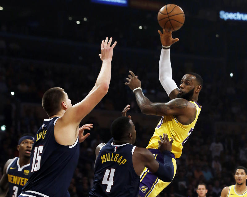 LeBron's Lakers rally for first home victory