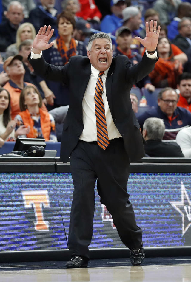 Auburn head coach Bruce Pearl yells from the sidelines during the first half in an NCAA college basketball quarterfinal game against Alabama at the Southeastern Conference tournament Friday, March 9, 2018, in St. Louis. (AP Photo/Jeff Roberson)