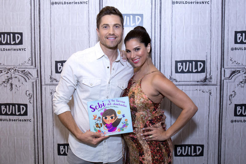 """Eric Winter and Roselyn Sanchez attend Build Presents to discuss their bilingual children's cook """"Sebi and the Land of Cha Cha Cha."""" (Santiago Felipe via Getty Images)"""