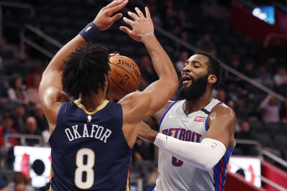Detroit Pistons center Andre Drummond (0) attempt a shot as New Orleans Pelicans center Jahlil Okafor (8) defends during the first half of an NBA basketball game, Monday, Jan. 13, 2020, in Detroit. (AP Photo/Carlos Osorio)
