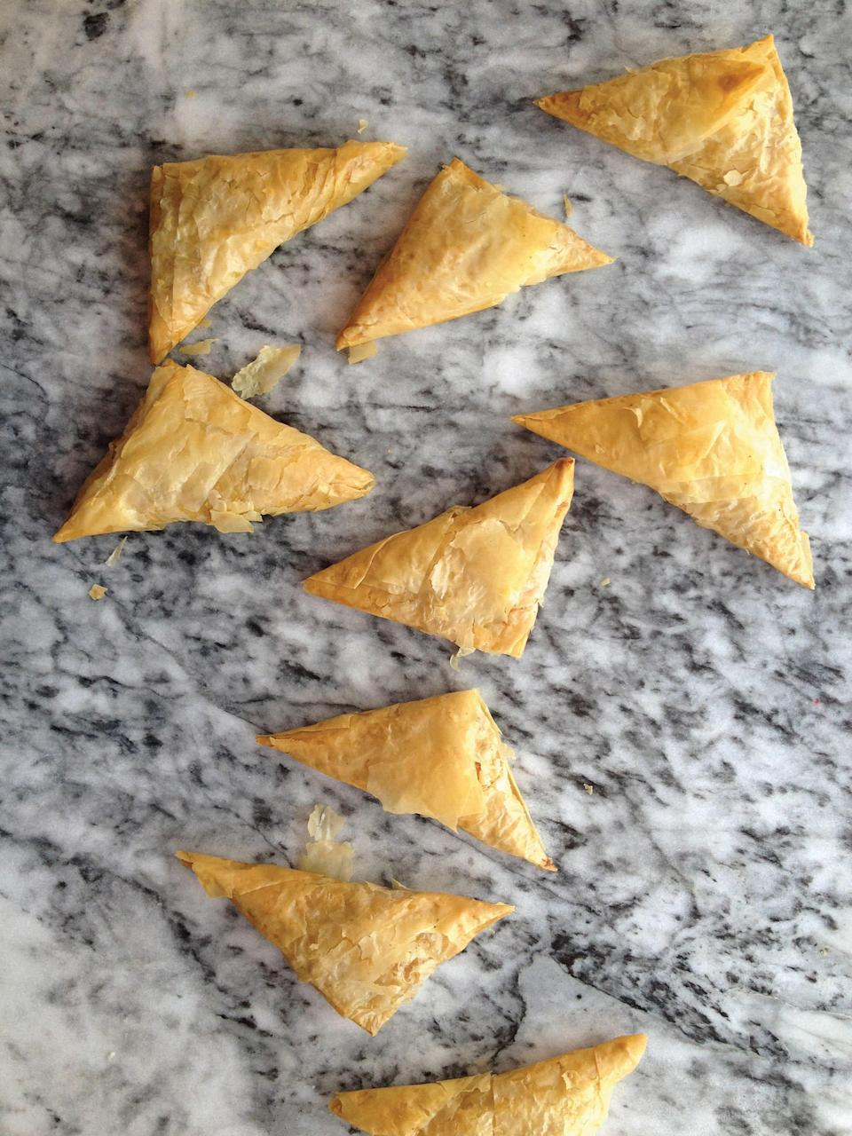 "We love these triangular pockets as an appetizer for any fall feast—though we'd also eat them for dinner alongside a green salad. <a href=""https://www.epicurious.com/recipes/food/views/pumpkin-kolokithopita-greek-phyllo-pastries?mbid=synd_yahoo_rss"" rel=""nofollow noopener"" target=""_blank"" data-ylk=""slk:See recipe."" class=""link rapid-noclick-resp"">See recipe.</a>"