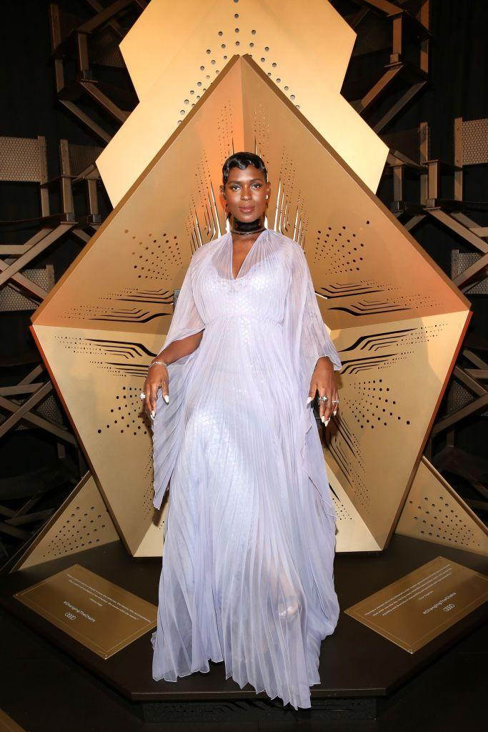 <p>The then-mother-to-be wore a lilac Gucci gown for the premiere.</p>