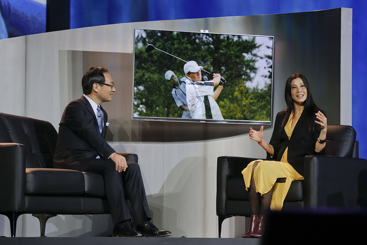 Lisa Ling, right, and Panasonic President and CEO Kazuhiro Tsuga discuss Panasonic's line of Smart TV's during a keynote address at the Consumer Electronics Show.