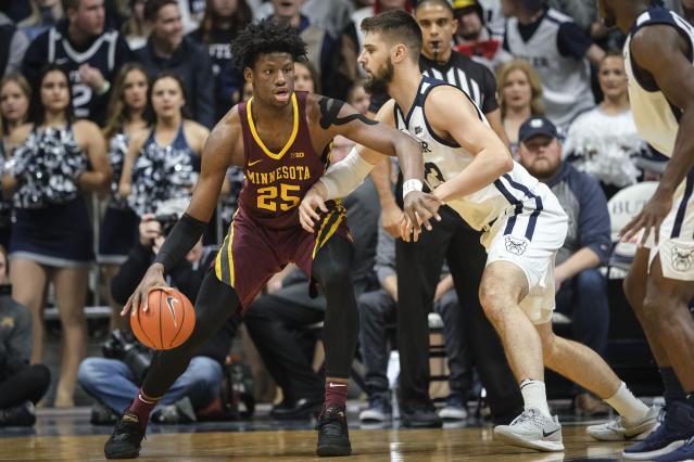 Minnesota center Daniel Oturu (25) backs Butler forward Bryce Golden (33) toward the basket in the first half of an NCAA college basketball game in Indianapolis, Tuesday, Nov. 12, 2019. (AP Photo/AJ Mast)