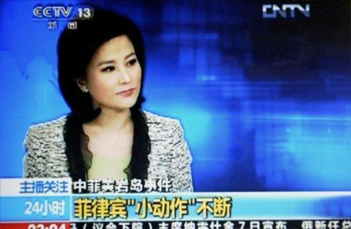 A TV grab from CCTV taken on May 7, shows He Jia, an anchor for China Central Television's news broadcast, when she claimed the Philippines as part of China during a late broadcast that has been repeatedly replayed on the Internet