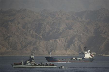 An Israeli Navy boat escorts the Panamanian-flagged cargo vessel Klos C into the Israeli port of Eilat on Saturday after seizing it in the Red Sea on Wednesday