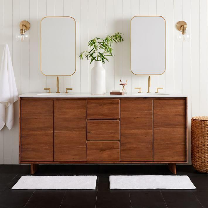 """<p>Just because it's a household name doesn't take away from the high quality of West Elm's pieces, like the <a href=""""https://go.skimresources.com?id=74968X1525087&xs=1&url=https%3A%2F%2Fwww.westelm.com%2Fproducts%2Fanton-double-bathroom-vanity-78-b3683%2F%3Fpkey%3Dcbathroom-furniture"""" rel=""""nofollow noopener"""" target=""""_blank"""" data-ylk=""""slk:Anton Double Bathroom Vanity"""" class=""""link rapid-noclick-resp"""">Anton Double Bathroom Vanity</a>. </p><p><a class=""""link rapid-noclick-resp"""" href=""""https://go.skimresources.com?id=74968X1525087&xs=1&url=https%3A%2F%2Fwww.westelm.com%2F%3Fcm_type%3Dgnav%26cm_sp%3DGlobalLinks-_-Topnav-_-WestElmLogo"""" rel=""""nofollow noopener"""" target=""""_blank"""" data-ylk=""""slk:Shop"""">Shop</a> </p>"""