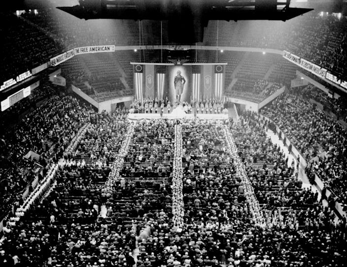 """Nazi storm troopers fill the aisles of Madison Square Garden as the crowd sings """"The Star Spangled Banner"""" at the opening of the German-American Bund's Americanization Rally on Feb. 20, 1939. (Photo: Larry Froeber/NY Daily News Archive via Getty Images)"""