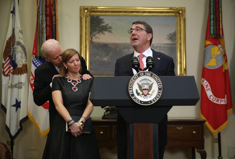 Vice President Biden stood close behind the wife of Defense Secretary Ash Carter at Carter's swearing-in ceremony in 2015. (Alex Wong/Getty Images)