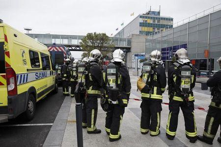Emergency services  at Orly airport southern terminal after shooting incident near Paris