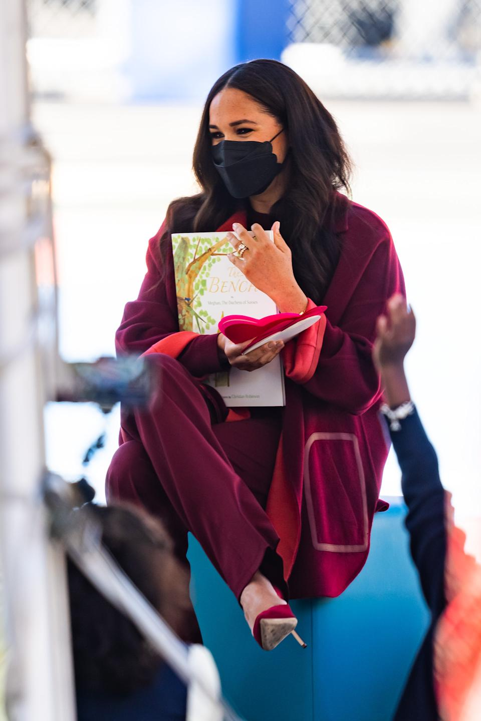 Meghan Markle, Duchess of Sussex reads to school children from her book, The Bench in Harlem on September 24, 2021 in New York City