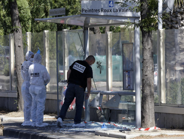 <p>Policce officers inspect a bus stop in La Valentine district after a van rammed into two bus stops in the French port city of Marseille, southern France, Aug.21, 2017. (Photo: Claude Paris/AP) </p>