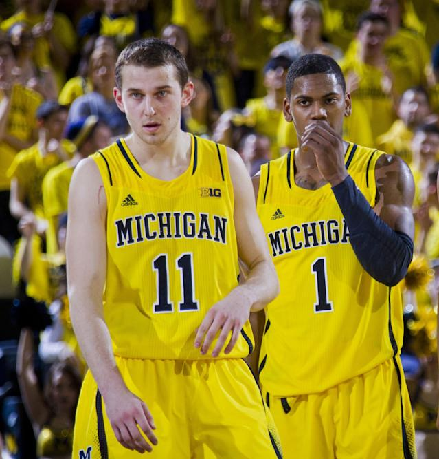 FILE - In this Feb. 23, 2014 file photo, Michigan guard Nik Stauskas (11), and forward Glenn Robinson III (1) stand on the court after a time out in the second half of an NCAA college basketball game against Michigan State, at Crisler Center in Ann Arbor, Mich. Sophomores Robinson and Stauskas helped the Wolverines win the Big Ten title and reach an NCAA tournament regional final last season.(AP Photo/Tony Ding, File)