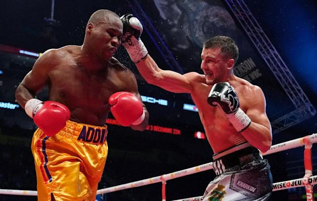 Oleksandr Gvosdyk (R) punches Adonis Stevenson during their WBC light heavyweight championship fight on December 1, 2018 (AFP Photo/MATHIEU BELANGER)