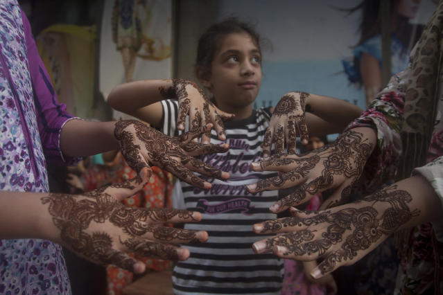 <p>Pakistani girls show their hands painted with henna ahead of the Muslim holiday of Eid al-Fitr in Karachi, Pakistan, July 28, 2014. Pakistani Muslims will celebrate the Eid al-Fitr holiday that marks the end of the holy fasting month of Ramadan. (AP Photo/Shakil Adil) </p>