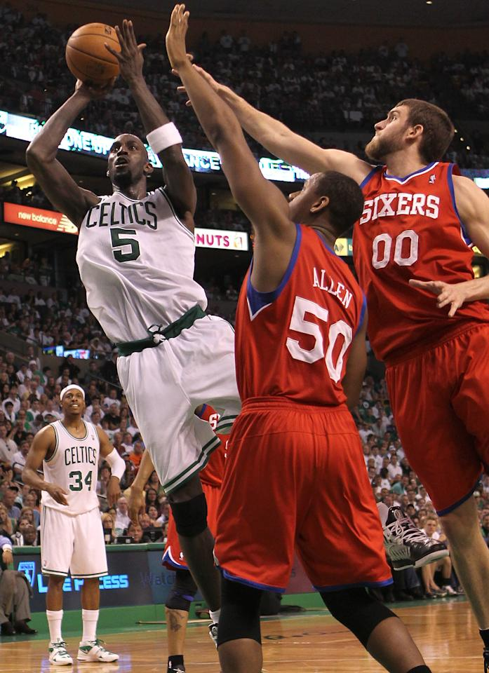 BOSTON, MA - MAY 26:  Kevin Garnett #5 of the Boston Celtics shoots by the defense of Lavoy Allen #50 and Spencer Hawes #0 of the Philadelphia 76ers during Game Seven of the Eastern Conference Semifinals during the 2012 NBA Playoffs on May 26, 2012 at TD Garden in Boston, Massachusetts. NOTE TO USER: User expressly acknowledges and agrees that, by downloading and or using this photograph, User is consenting to the terms and conditions of the Getty Images License Agreement. (Photo by Jim Rogash/Getty Images)