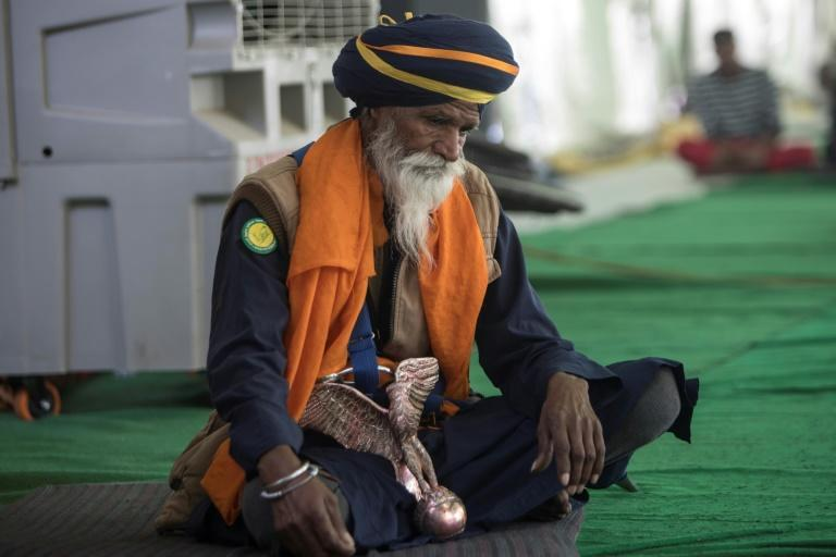 Most Sikhs carry daggers as religious symbols and wear turbans, but Nihangs stand out with their robes and weaponry
