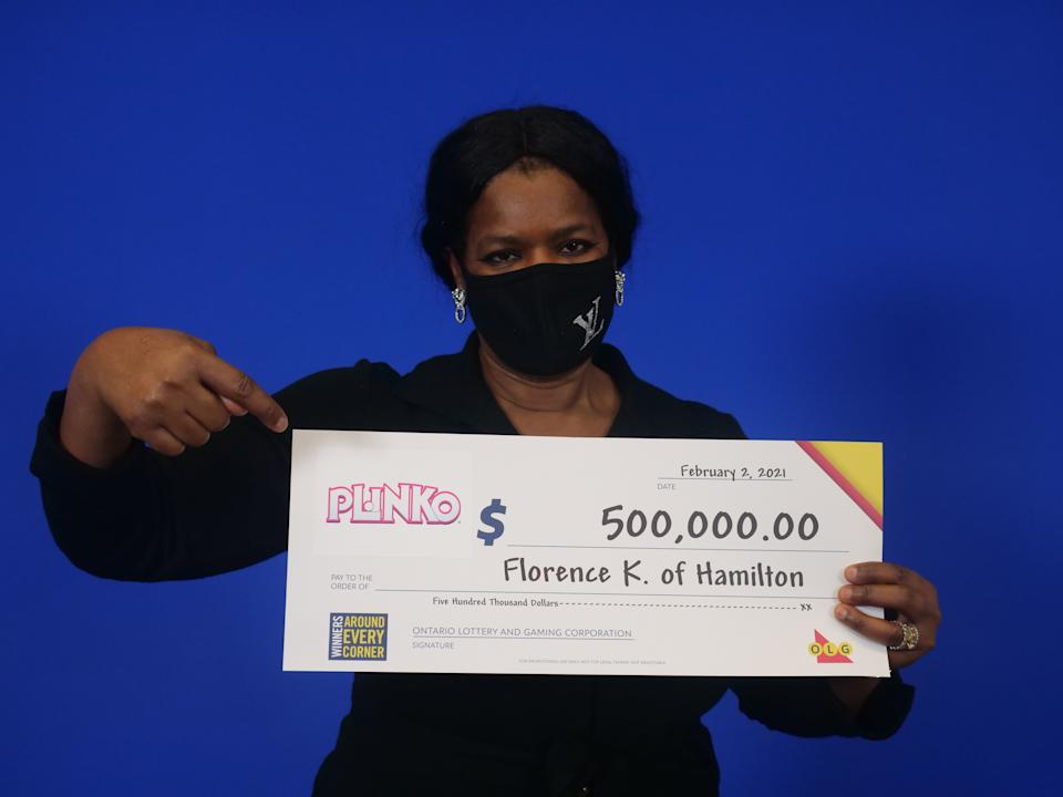 Florence Kalu from Hamilton, Ont., won the first $500,000 Plinko prize. The Plinko board is the same as the one that appears in 'The Price is Right'. (OLG)