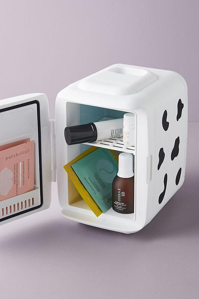 """For face masks and moisturizers, you can turn to this beauty fridge that can keep them cool. It can also switch between cooling and warming. We're big fans of this cow print.<a href=""""https://fave.co/2HAqLuO"""" target=""""_blank"""" rel=""""noopener noreferrer"""">Find it for $60 at Anthropologie</a>."""