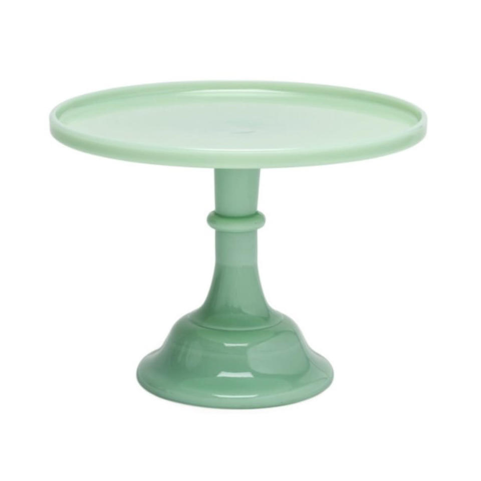 """<p>Make any layer cake look even prettier by displaying it on the counter in this retro cake stand. May we suggest our classic <a href=""""https://www.southernliving.com/recipes/old-fashioned-caramel-cake"""" rel=""""nofollow noopener"""" target=""""_blank"""" data-ylk=""""slk:Caramel Cake?"""" class=""""link rapid-noclick-resp"""">Caramel Cake?</a></p> <p><strong>Buy It: $35 and up; <a href=""""http://www.anrdoezrs.net/links/7799179/type/dlg/sid/SLJadeiteIstheRetroKitchenTrendWereLovingRightNowHereAre10FavoriteItemsToShopOnlinekyarborough1271KitGal7861931202008I/https://www.onekingslane.com/p/2744983-cake-plate-jadeite.do"""" rel=""""nofollow noopener"""" target=""""_blank"""" data-ylk=""""slk:onekingslane.com"""" class=""""link rapid-noclick-resp"""">onekingslane.com</a></strong></p>"""