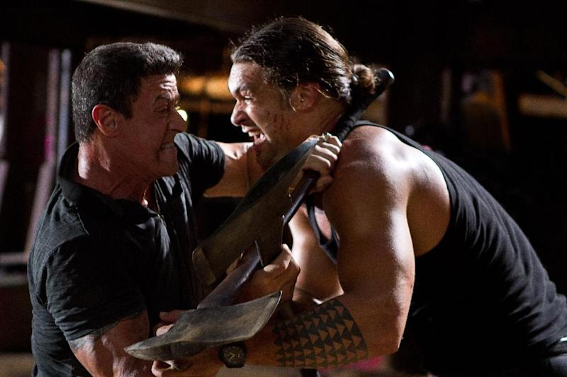 "This film image released by Warner Bros. Pictures shows Sylvester Stallone, left, and Jason Momoa in a scene from ""Bullet to the Head."" (AP Photo/Warner Bros. Pictures, Frank Masi)"
