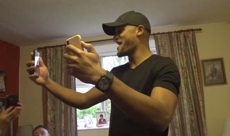 Vincent Kompany celebrates Manchester City's Premier League title with teammates. (Screenshot: Manchester City on Periscope)