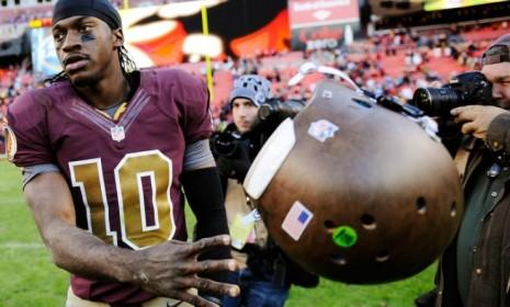"""Washington Redskins quarterback Robert Griffin III tosses his helmet after losing on Nov. 4, a result that could be bad news for Obama, according to a piece of superstition known as the """"Redskins Rule."""""""