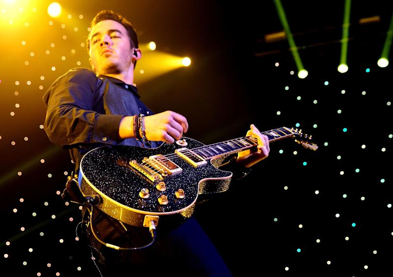 LOS ANGELES, CA - DECEMBER 01: Musician Kevin Jonas of the Jonas Brothers performs onstage during KIIS FM's 2012 Jingle Ball at Nokia Theatre L.A. Live on December 1, 2012 in Los Angeles, California. (Photo by Christopher Polk/Getty Images for Clear Channel)