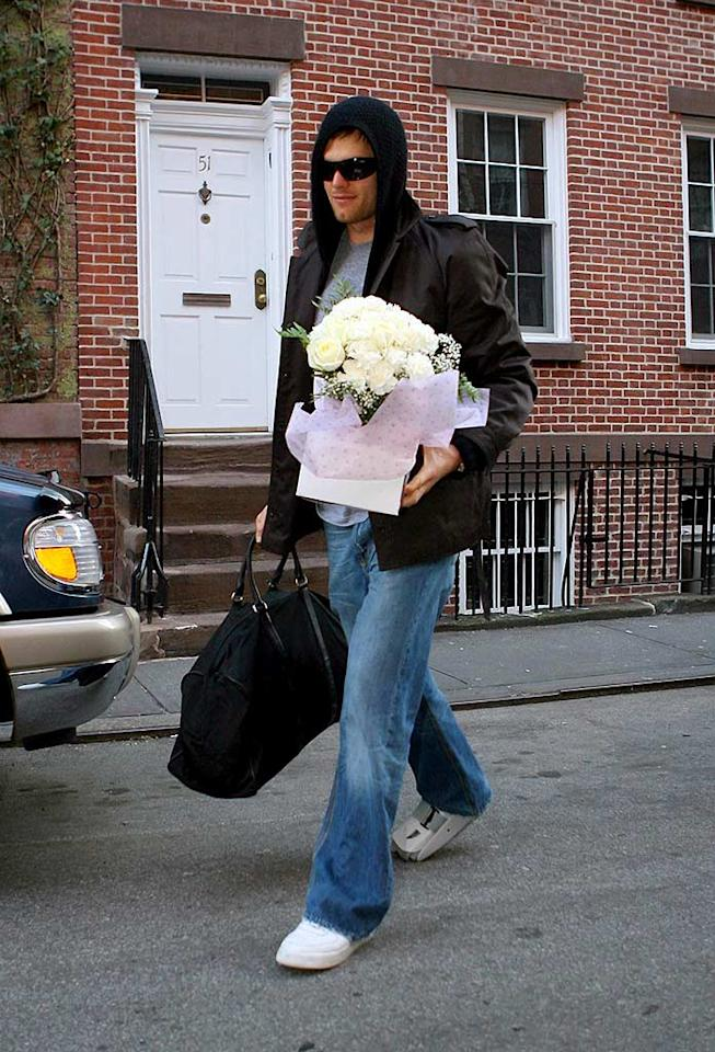 """Despite nursing a sprained ankle, Tom Brady hand-delivered flowers to his girlfriend Gisele Bunchen the day after winning the AFC Conference title. Wonder what he'll bring the supermodel if he wins the Superbowl? <a href=""""http://www.infdaily.com"""" target=""""new"""">INFDaily.com</a> - January 21, 2008"""