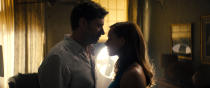 """This image released by Warner Bros. Pictures shows Hugh Jackman, left, and Rebecca Ferguson in a scene from """"Reminiscence."""" (Warner Bros. Pictures via AP)"""
