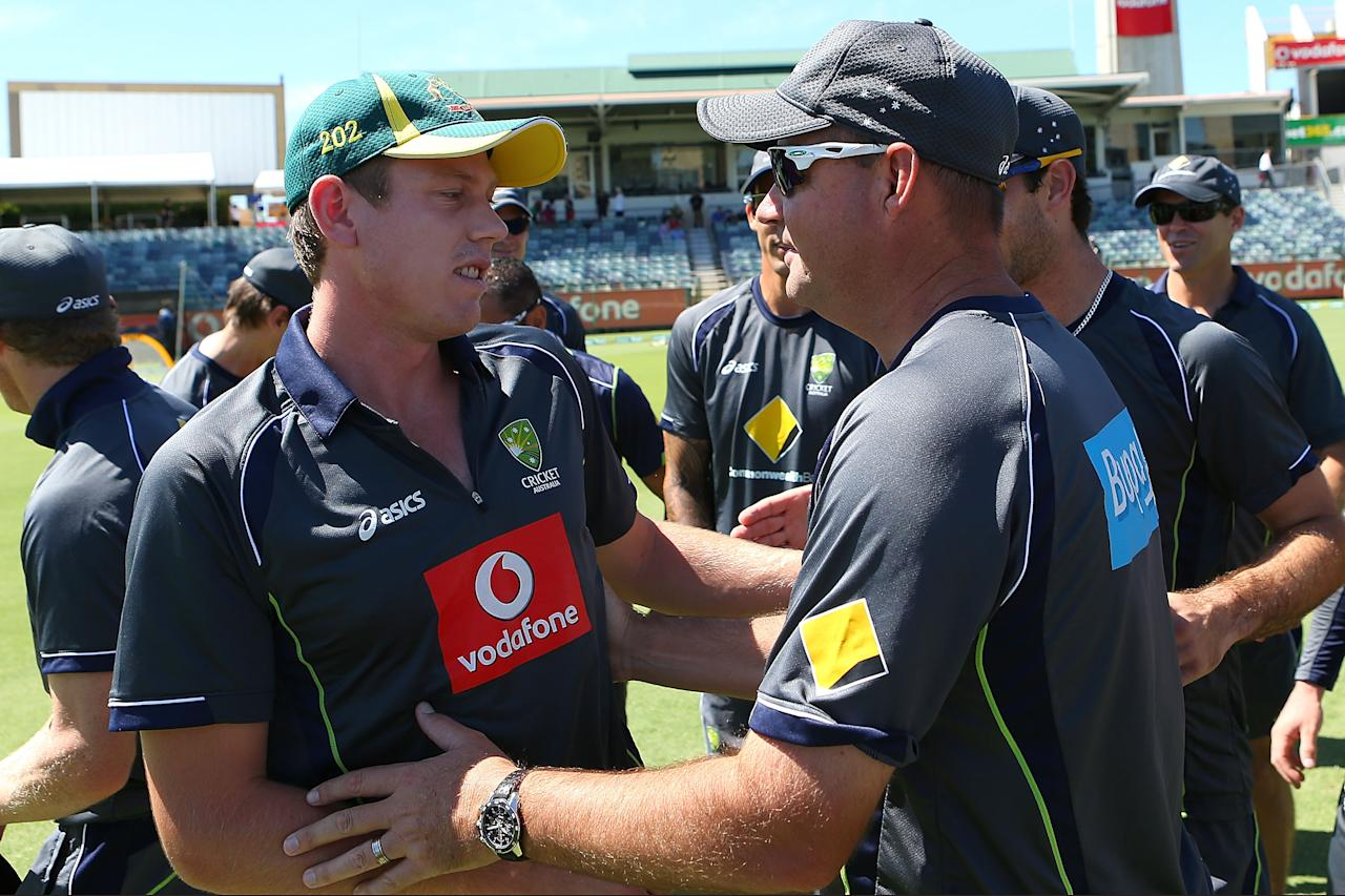 PERTH, AUSTRALIA - FEBRUARY 01:  James Faulkner of Australia is congratulated by coach Mickey Arthur after his cap presentation before game one of the Commonwealth Bank One Day International Series between Australia and the West Indies at WACA on February 1, 2013 in Perth, Australia.  (Photo by Paul Kane/Getty Images)