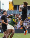 New Zealand's Jordie Barrett leaps to catch the ball during the Rugby Championship test match between the Springboks and the All Blacks in Townsville, Australia, Saturday, Sept. 25, 2021. (AP Photo/Tertius Pickard)