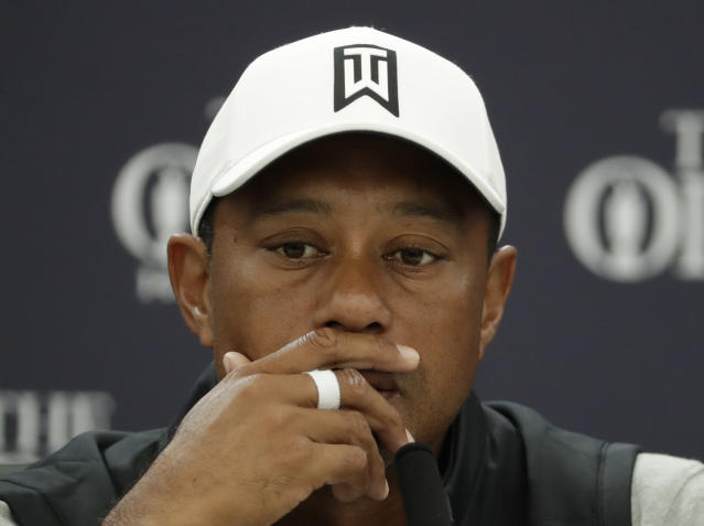 Tiger Woods of the United States listens to a question from the media during a press conference ahead of the start of the British Open golf championships at Royal Portrush in Northern Ireland, Tuesday, July 16, 2019. The British Open starts Thursday. (AP Photo/Matt Dunham)