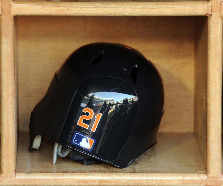Detroit Tigers' Delmon Young's batting helmet sits in the rack before the Tigers played the New York Yankees in a baseball game Friday, April 27, 2012 at Yankee Stadium in New York. Young was arrested Friday in New York on a hate crime harassment charge after police said he got into a fight with a group of men and yelled anti-Semitic epithets. (AP Photo/Bill Kostroun)