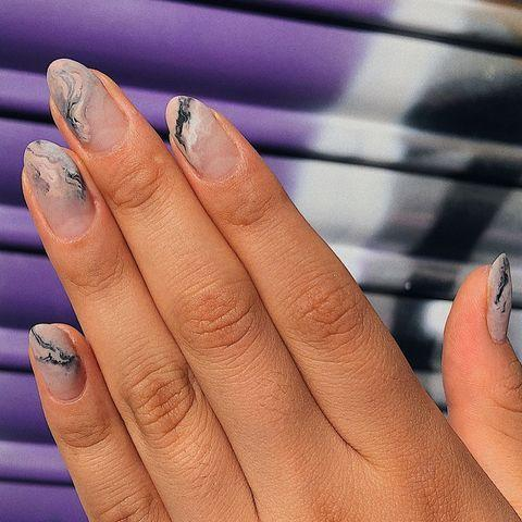 """<p>We love this modern take on the <a href=""""https://www.cosmopolitan.com/uk/beauty-hair/nails/g28735671/marble-nails/"""" rel=""""nofollow noopener"""" target=""""_blank"""" data-ylk=""""slk:marble nail"""" class=""""link rapid-noclick-resp"""">marble nail</a> trend.</p><p><a href=""""https://www.instagram.com/p/BzVBcHZonxo/"""" rel=""""nofollow noopener"""" target=""""_blank"""" data-ylk=""""slk:See the original post on Instagram"""" class=""""link rapid-noclick-resp"""">See the original post on Instagram</a></p>"""