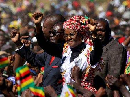FILE PHOTO: President Robert Mugabe and his wife Grace greet supporters of his ZANU (PF) party during a rally in Harare