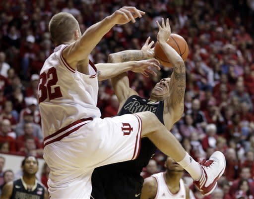 Purdue guard Anthony Johnson, right, is fouled as he shoots by Indiana forward Derek Elston in the first half of a NCAA college basketball game in Bloomington, Ind., Saturday, Feb. 16, 2013. (AP Photo/Michael Conroy)