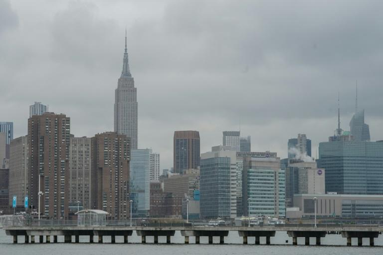 The Empire State Building rises over empty piers on the East River in the Greenpoint section of Brooklyn