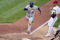 Milwaukee Brewers' Omar Narvaez (10) scores on a wild pitch by Pittsburgh Pirates relief pitcher Chris Stratton (46) during the sixth inning of a baseball game in Pittsburgh, Saturday, July 3, 2021. (AP Photo/Gene J. Puskar)