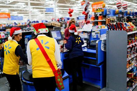 FILE PHOTO: Walmart workers organise products for Christmas season at a Walmart store in Teterboro, New Jersey, U.S., October 26, 2016. REUTERS/Eduardo Munoz/File Photo