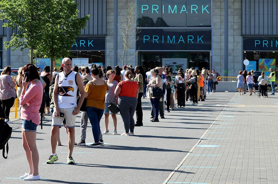 Shoppers queue in front of Primark in Rushden on 15th June, the day shops reopened in England after lockdown
