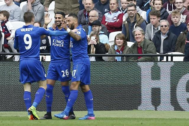 Leicester City's midfielder Riyad Mahrez (C) celebrates with striker Jamie Vardy (L) and defender Danny Simpson after scoring during the English Premier League football match against West Ham United March 18, 2017 (AFP Photo/Ian KINGTON)