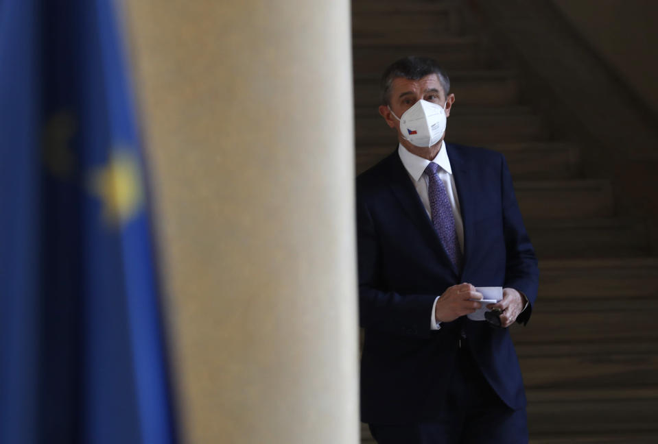 Czech Republic's Prime Minister Andrej Babis walks to address media at the Cernin's Palace in Prague, Czech Republic, Wednesday, April 21, 2021. (AP Photo/Petr David Josek)