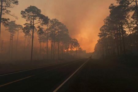 Smoke is seen during sunset as the West Mims fire burns in the Okefenokee National Wildlife Refuge