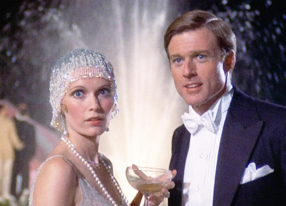 "LOS ANGELES - MARCH 29: The movie ""The Great Gatsby"", directed by Jack Clayton, based on the novel by F. Scott Fitzgerald. Seen here from left, Mia Farrow as Daisy Buchanan and Robert Redford as Jay Gatsby. Initial theatrical release March 29, 1974.  Screen capture. A Paramount Picture. (Photo by CBS via Getty Images)"