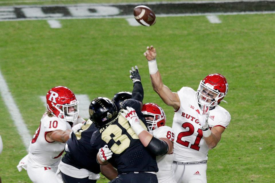 Rutgers quarterback Johnny Langan (21) throws as Purdue linebacker Jaylan Alexander (36) attempts to block during the fourth quarter of an NCAA college football game, Saturday, Nov. 28, 2020 at Ross-Ade Stadium in West Lafayette.
