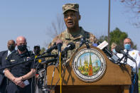 Brig. Gen. Michael J. Talley, commander of U.S. Army Medical Research and Development Command Fort Detrick, Md., joined by Frederick Maryland Police Chief Jason Lando, left, speaks during a news conference near the scene of a shooting at a business park in Frederick, Md., Tuesday, April 6, 2021. (AP Photo/Carolyn Kaster)