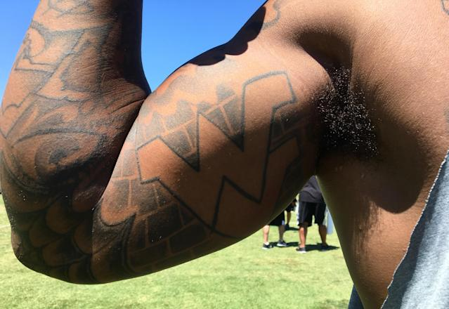 """<p>Bruce Irvin, defensive end, Oakland. The """"WVU"""" logo of his college, West Virginia. """"I am proud to be a Mountaineer. I talk about West Virginia, I tweet about West Virginia. They've stuck by me, I've stuck by them. I had other offers to go to school and play, but I felt like they needed me and I needed them. I could have gone to LSU or Tennessee or USC, but I'd have been just another guy. West Virginia, they told me I could be a big fish in a smaller pond. I liked that. My rookie year, I donated money to the school for the weight room, and they named the weight room after me. That was cool.'' </p>"""
