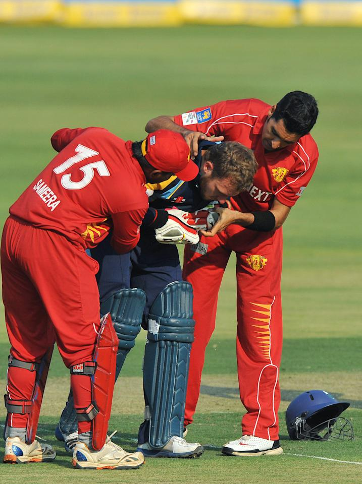 JOHANNESBURG, SOUTH AFRICA - OCTOBER 09:  David Miller of Yorkshire receives attention after being struck by Umar Gul of Uva during the Karbonn Smart CLT20 pre-tournament Qualifying Stage match between Yorkshire (England) and Uva Next (Sri Lanka) at Bidvest Wanderers Stadium on October 09, 2012 in Johannesburg, South Africa.  (Photo by Duif du Toit/Gallo Images/Getty Images)