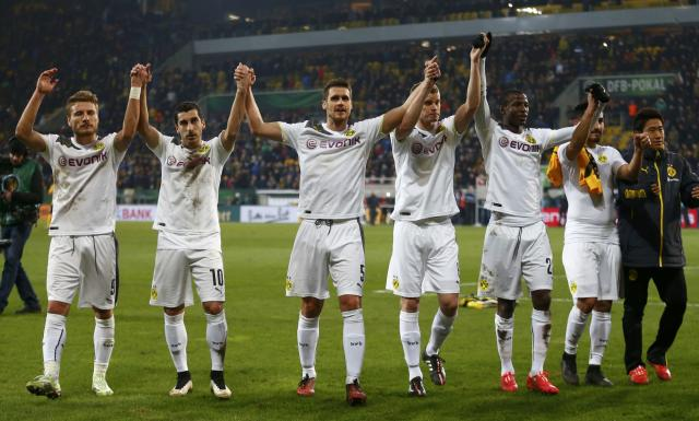 Borussia Dortmund L-R Ciro Immobile, Henrikh Mkhitaryan, Sven Bender, Vasquez Ramos, Ilkay Guendogan and Shinji Kagawa celebrate their victory against Dynamo Dresden following their German Cup (DFB Pokal) soccer match in Dresden March 3, 2015. REUTERS/Hannibal Hanschke (GERMANY - Tags: SOCCER SPORT) DFB RULES PROHIBIT USE IN MMS SERVICES VIA HANDHELD DEVICES UNTIL TWO HOURS AFTER A MATCH AND ANY USAGE ON INTERNET OR ONLINE MEDIA SIMULATING VIDEO FOOTAGE DURING THE MATCH.